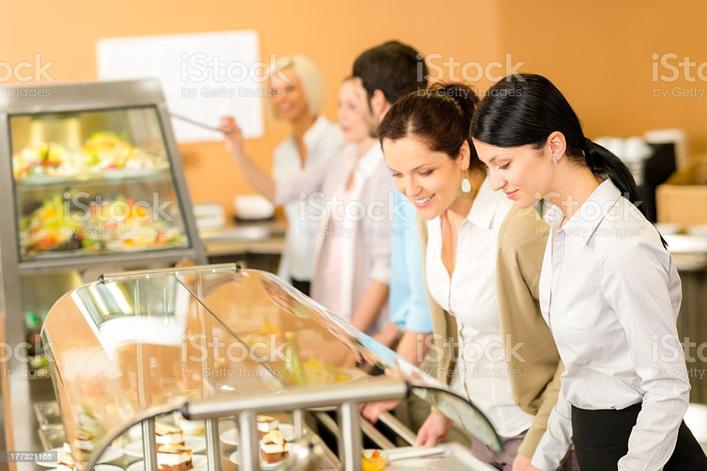 Cafeteria lunch two office woman choose food stock photo