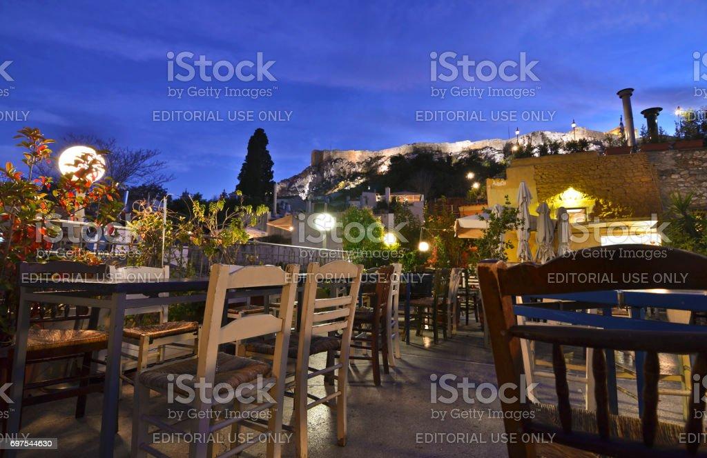 cafeteria on terrace Anafiotika Plaka Greece with Acropolis view stock photo