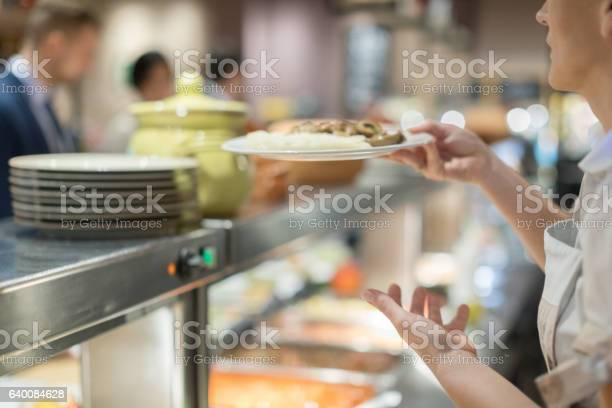 Cafeteria worker serving lunch picture id640084628?b=1&k=6&m=640084628&s=612x612&h=f4sryte3kz0sogxgb5gnvfxtf3abihgv t3xaozszzm=