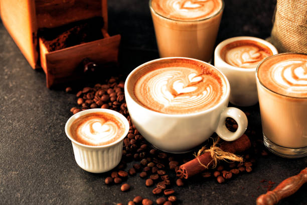 Caffe latte and a bunch of coffee beans stock photo