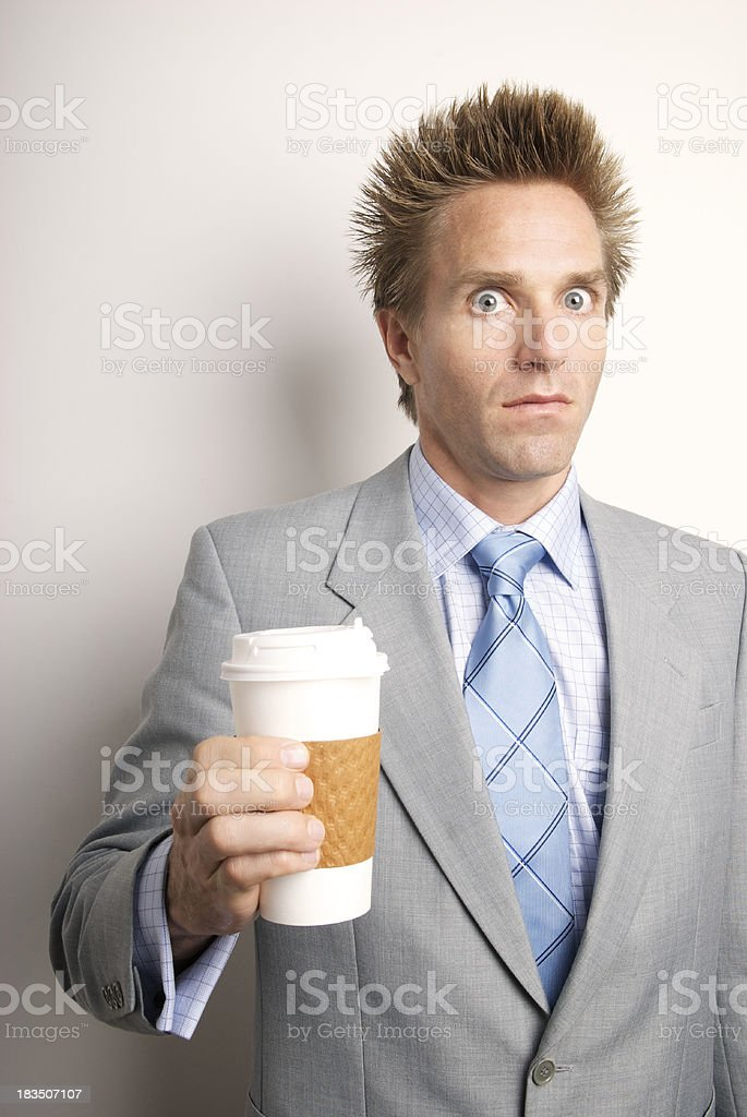 Caffeinated Businessman Holds Cup of Takeaway Coffee royalty-free stock photo
