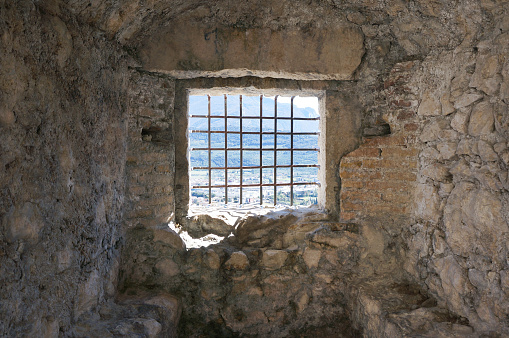 Cage window in old tower