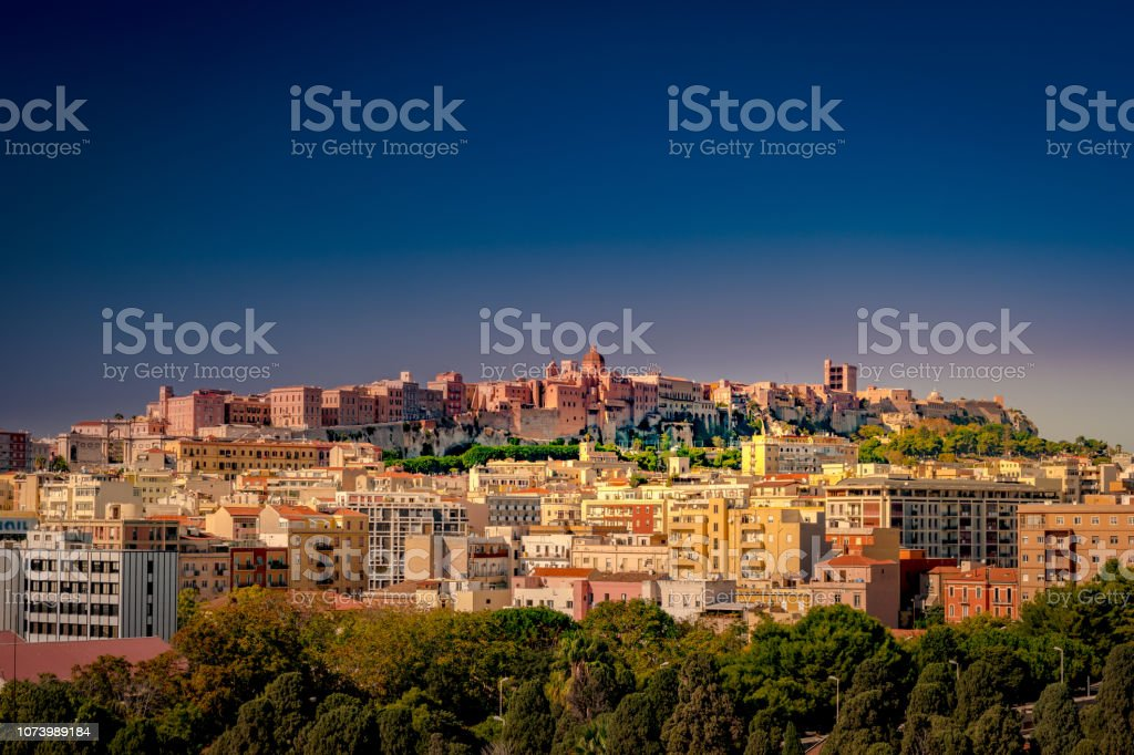 Cagliari at sunset, capital of the region of Sardinia, Italy. stock photo