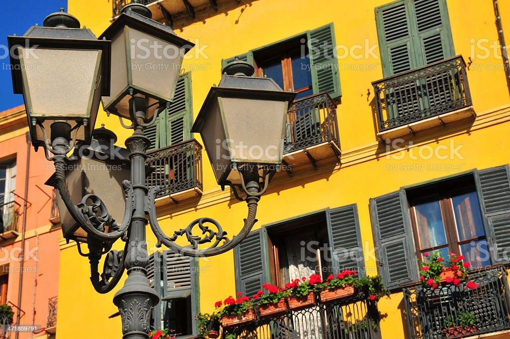 Cagliari, Sardinia,Italy: Mediterranean façade and public lamp stock photo