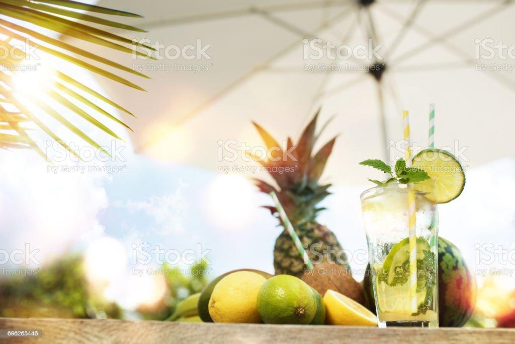 Caipirinha cocktail with exotic fruits stock photo