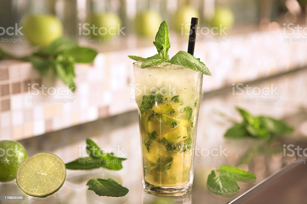 Caipirinha cocktail with fresh mint leaves and sliced lime royalty-free stock photo