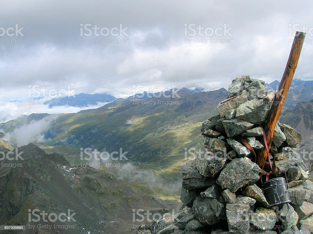 cairn and mountain summit in the Swiss Alps stock photo