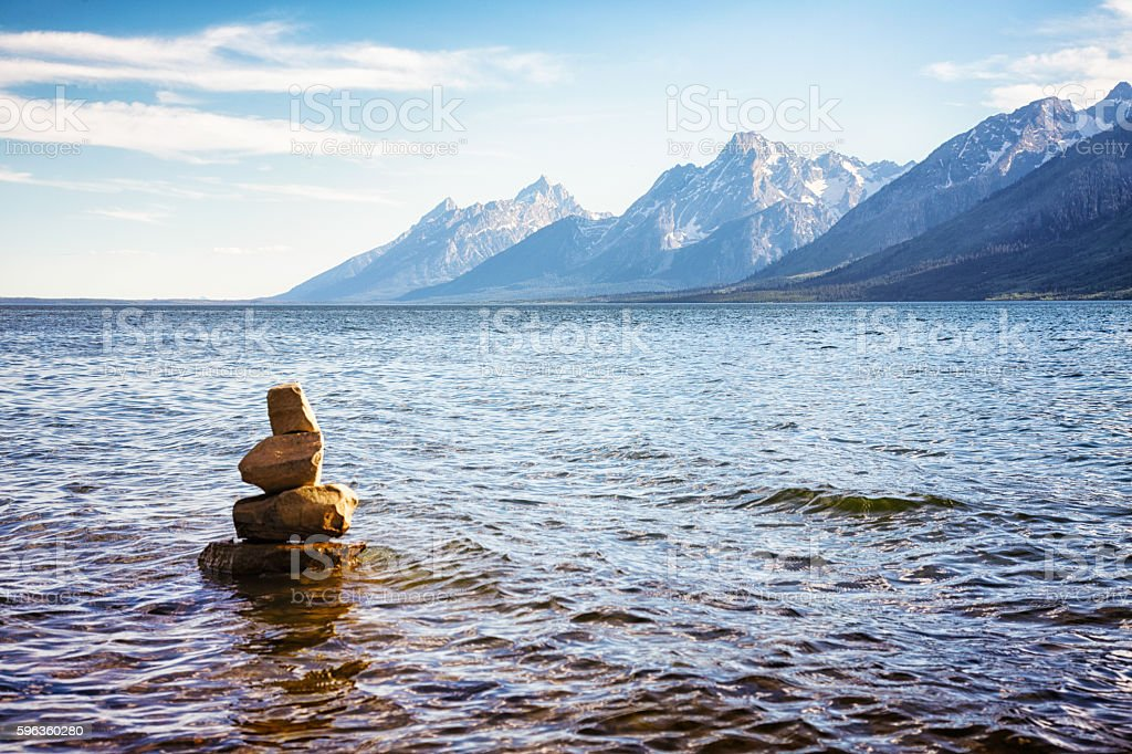 Cairn in lake water by the Grand Teton range royalty-free stock photo