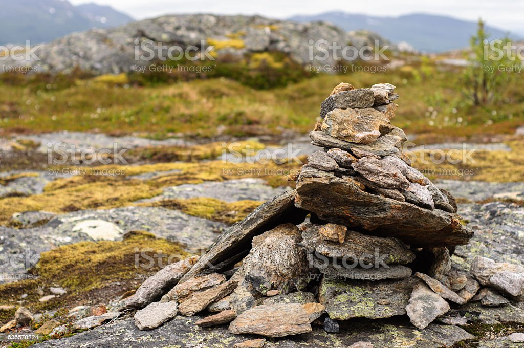 Cairn on the top of mountain in Lofoten, Norway stock photo