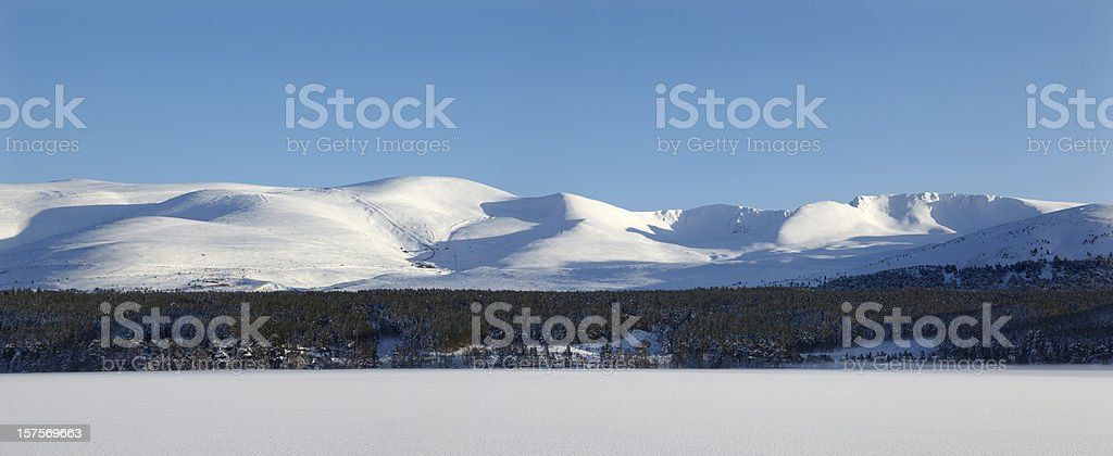 Cairngorms Mountains with Loch Morlich in winter mist stock photo