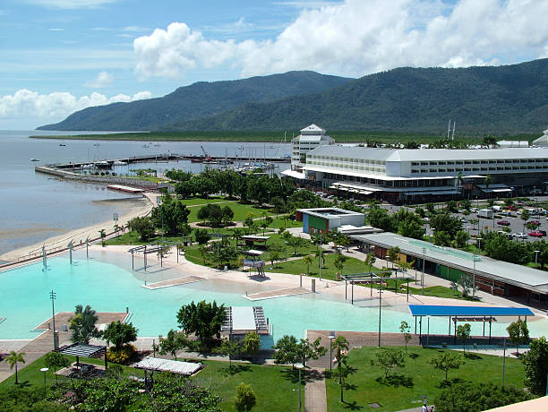 Cairns Lagoon and Pier Elevated view of the Cairns swimming lagoon, pier marketplace and Trinity Inlet esplanade theater stock pictures, royalty-free photos & images