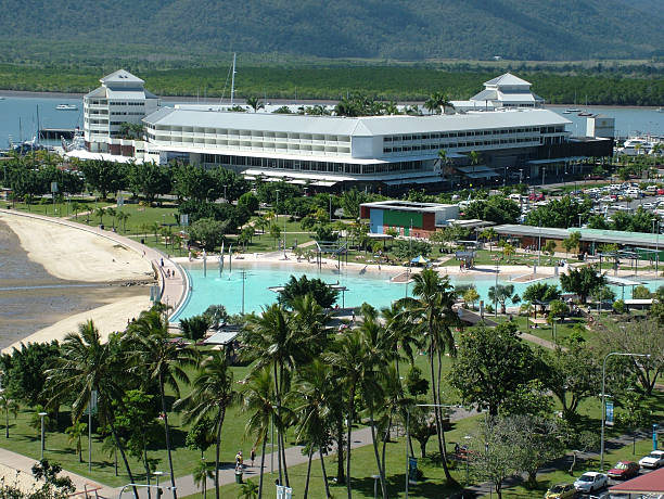 Cairns Lagoon Elevated view of the Cairns swimming lagoon, pier marketplace and Trinity Inlet esplanade theater stock pictures, royalty-free photos & images