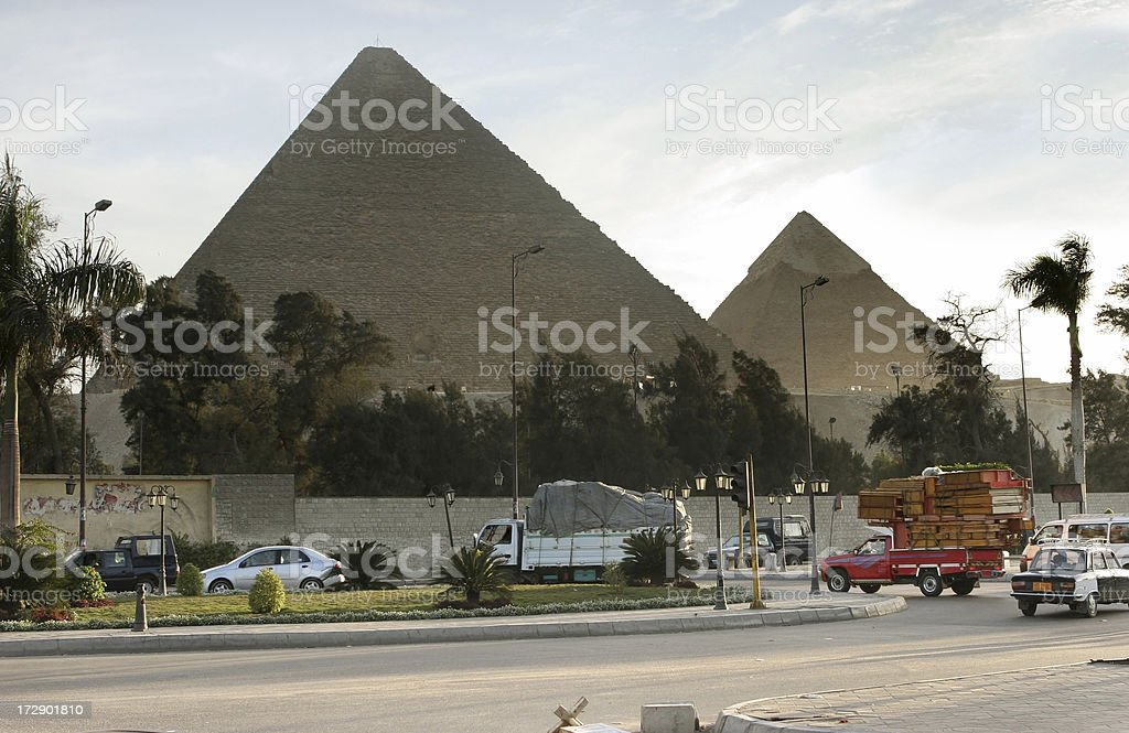 Cairo city traffic with pyramids of Khafre and Khufu royalty-free stock photo