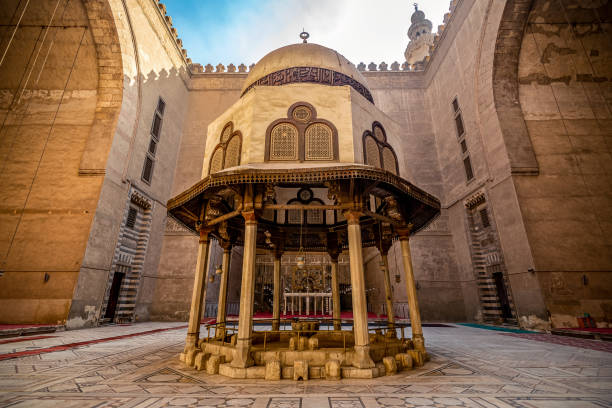 18/11/2018 Cairo, Egypt, the interior of the main hall for the prayers of the ancient and largest mosque in Cairo with a well in the center stock photo