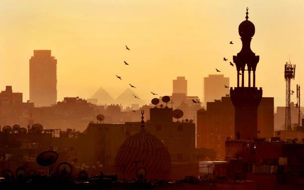 Cairo skyline and pyramids stock photo