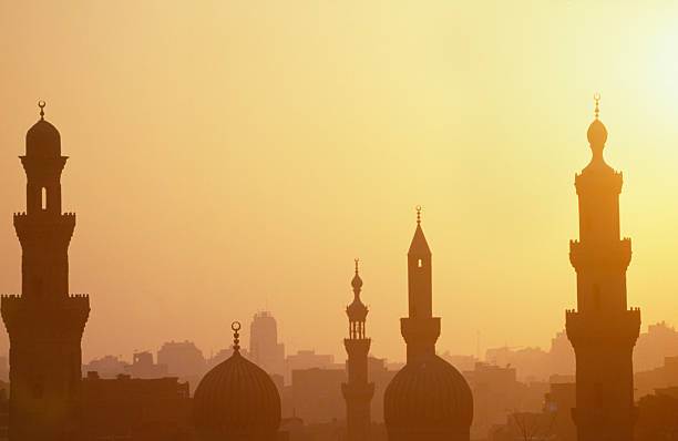 Cairo sunset with towers Cairo sunset with romantic towers minaret stock pictures, royalty-free photos & images