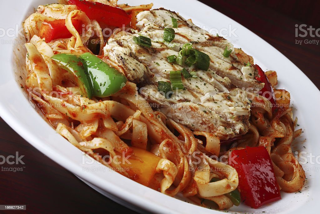 Cajun Pasta with Grilled Chicken Breasts and Seasoning royalty-free stock photo