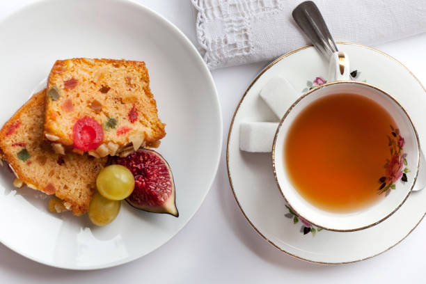 Cake and tea Cup of tea and fruits cake in a tea room tea room stock pictures, royalty-free photos & images