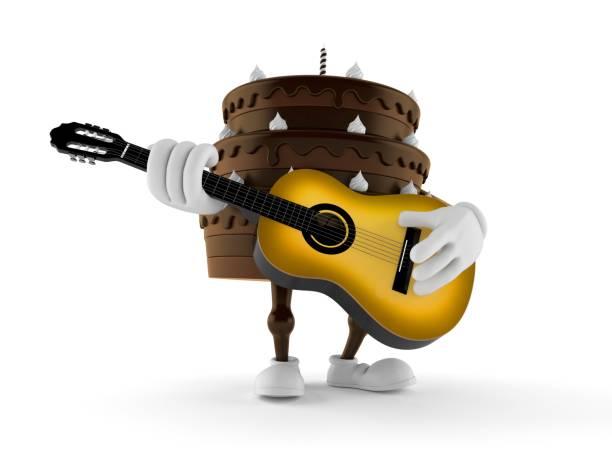 kuchencharakter beim gitarrenspielen - gitarren geburtstagstorten stock-fotos und bilder