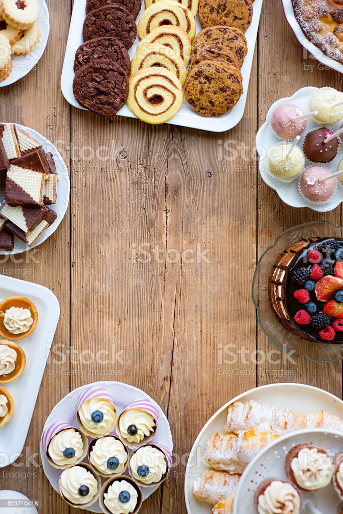 Cake, cookies, cakepops, waffers, cupcakes and tarts. Copy space stock photo