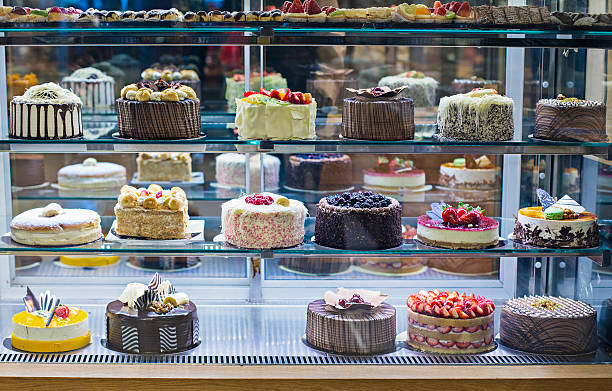 cake display - bakeries stock photos and pictures