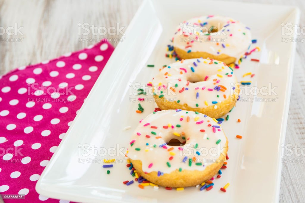 Cake Donuts On White Tray With Sprinkles stock photo