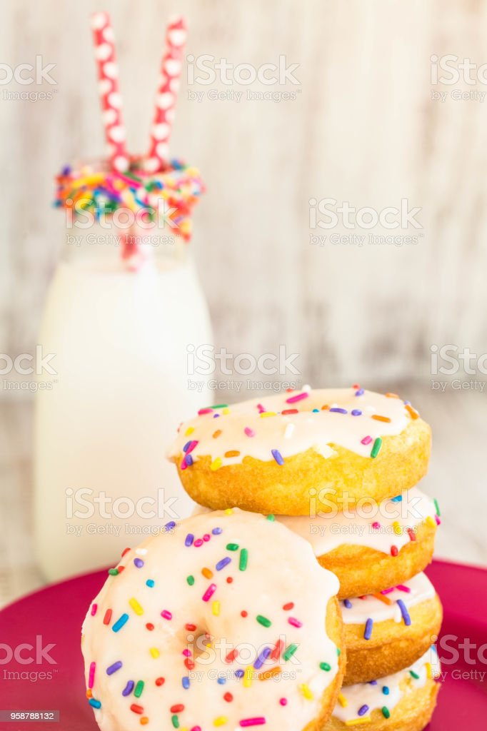 Cake Donuts With Glass Jar of Milk stock photo
