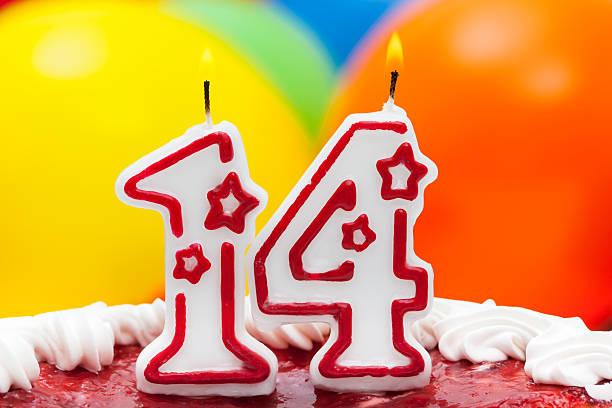 Cake for fourteenth birthday stock photo