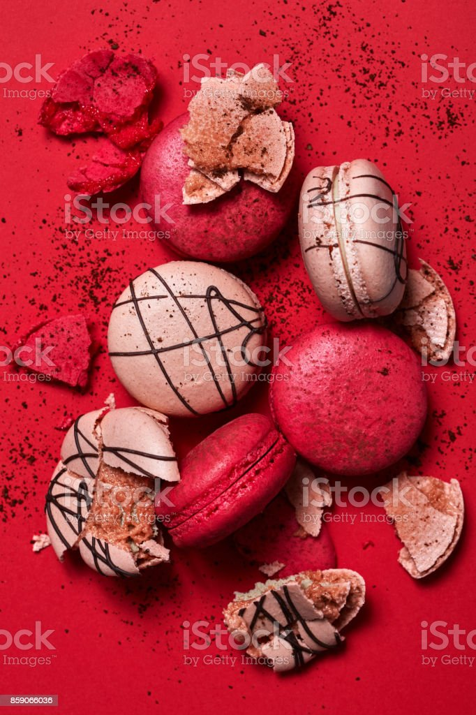 Cake macaroons on red background from above, almond cookies, top view stock photo