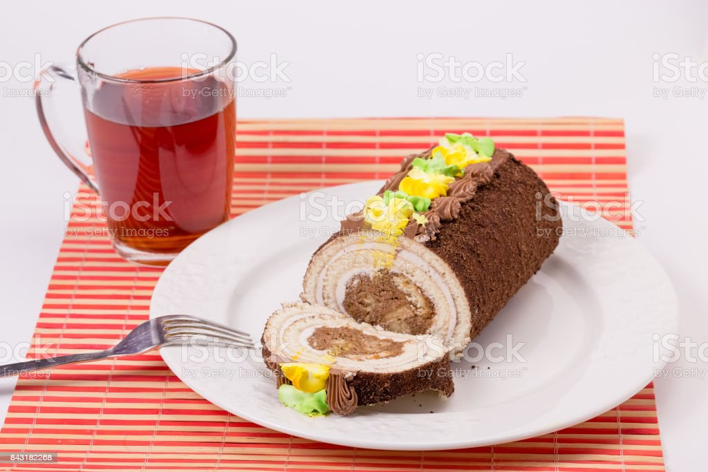 cake on plate and Cup of tea stock photo