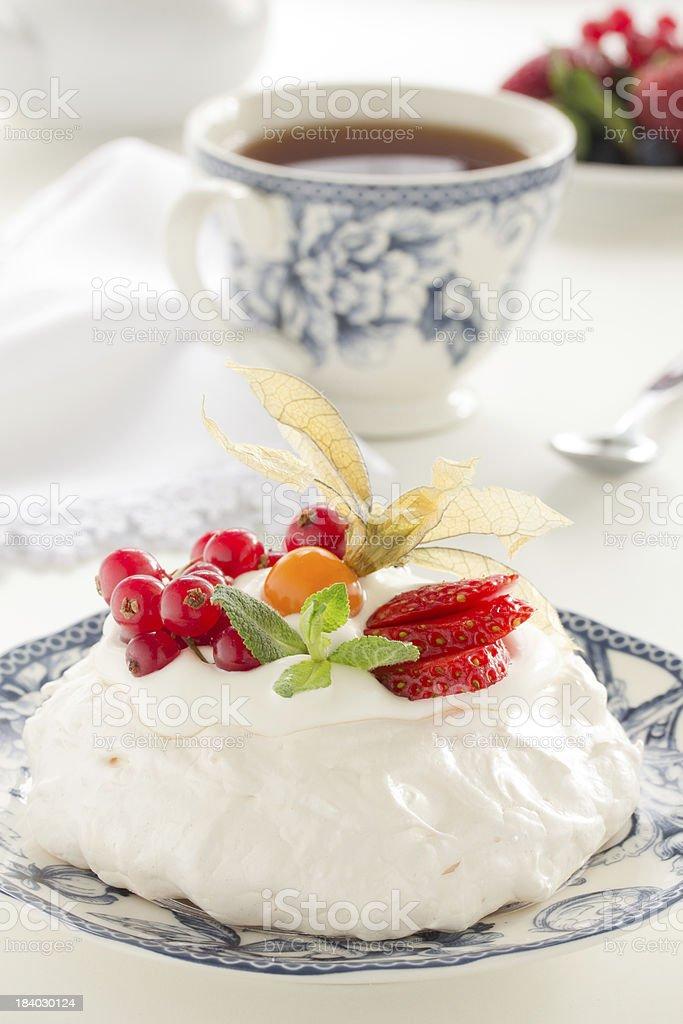 Cake 'Pavlova' with cream and berries. royalty-free stock photo