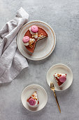 Slices of cake on plates and table
