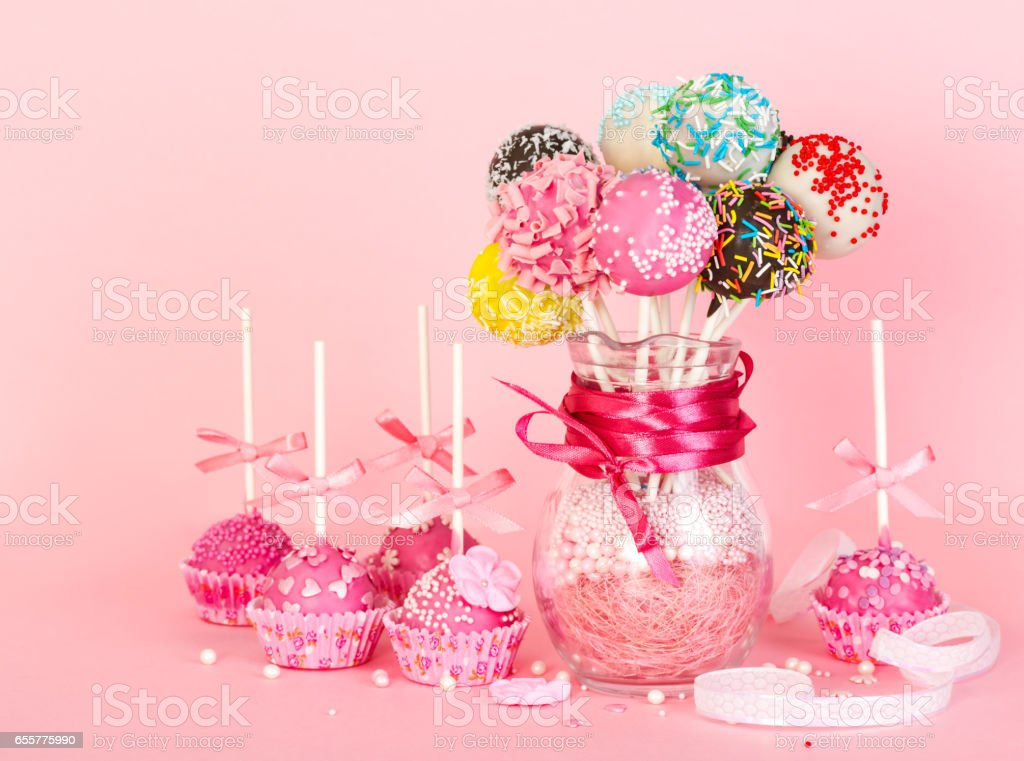 cake pops with pink icing and decoration on paper form and colorful cake pops in glass vase. Black Bedroom Furniture Sets. Home Design Ideas