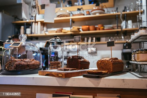 istock Cake shop, cafe or coffee shop with christmas chocolate or fruit cakes on the table. Winter cakes in cafe or coffeeshop. 1190440852