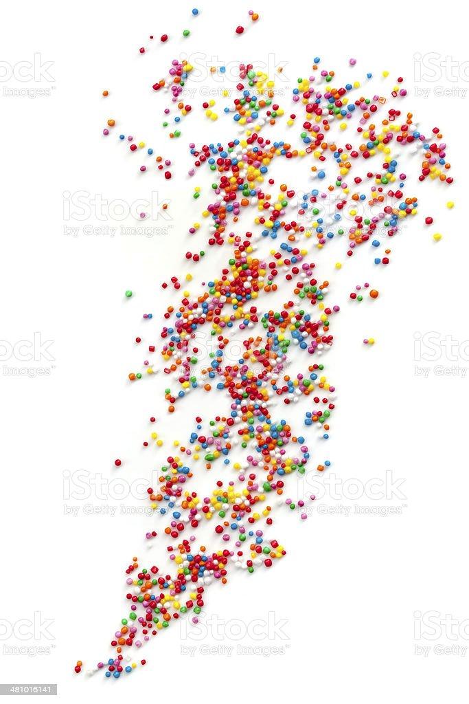 Cake Sprinkles Scattered over White Background stock photo
