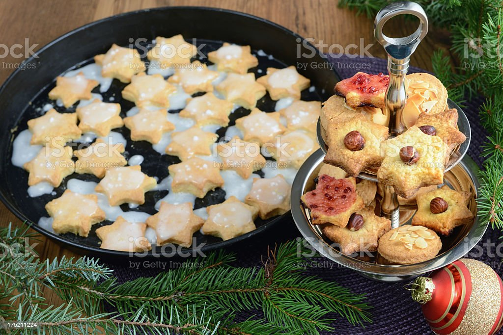 Cake stand with Christmas sweets like cinnamon pastry and biscuits. stock photo