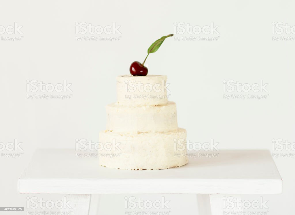 Cake tier decorated  fresh cherry on top. stock photo