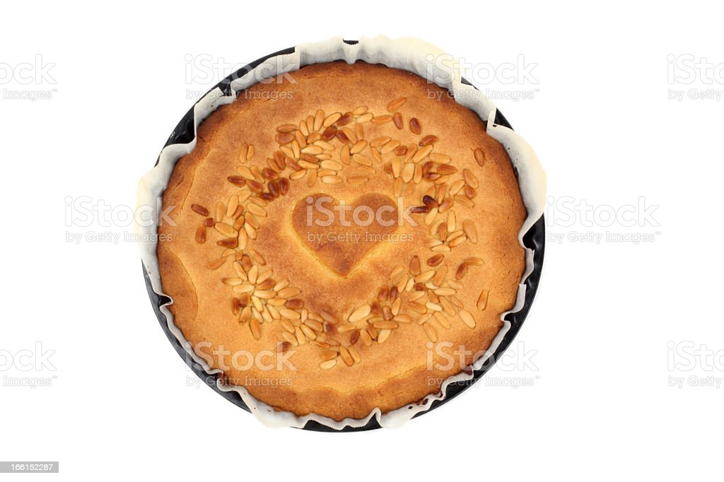 Cake with a heart and pine nuts royalty-free stock photo