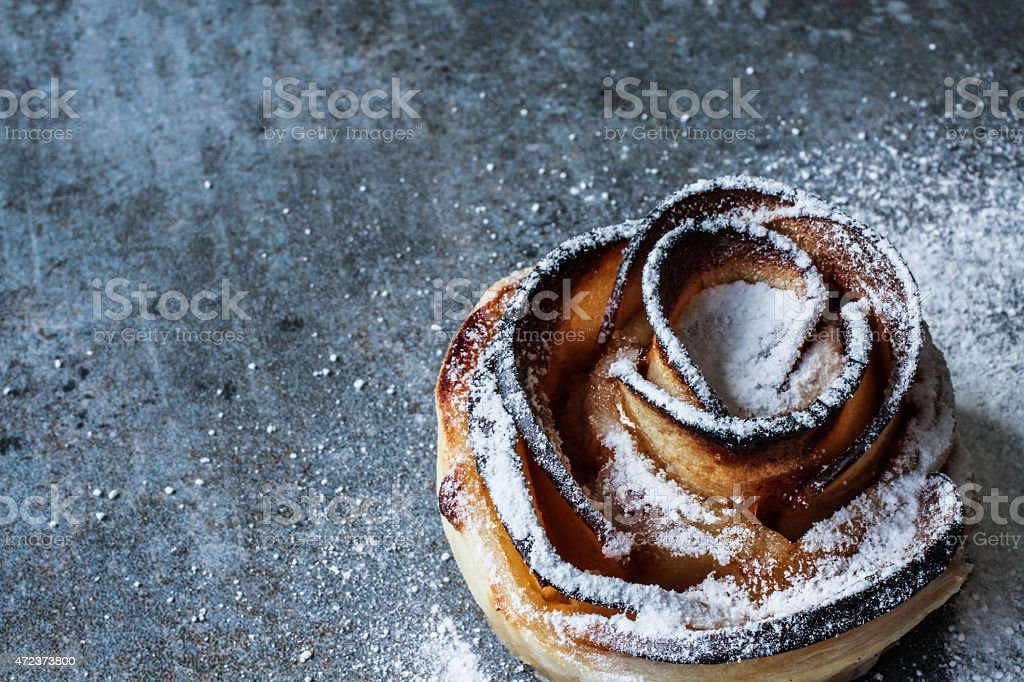 cake with apples, a delicious dessert on a gray background stock photo