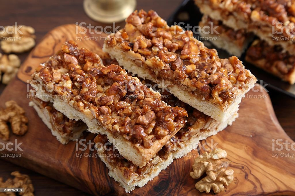 Cake with caramelized walnuts. stock photo