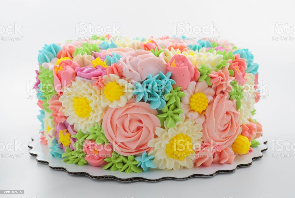 Cake with color cream flowers on white background. stock photo