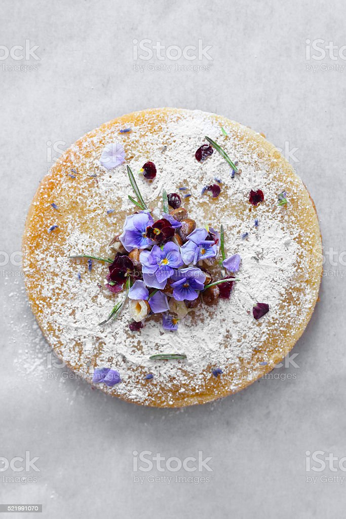 Cake with edible flowers stock photo