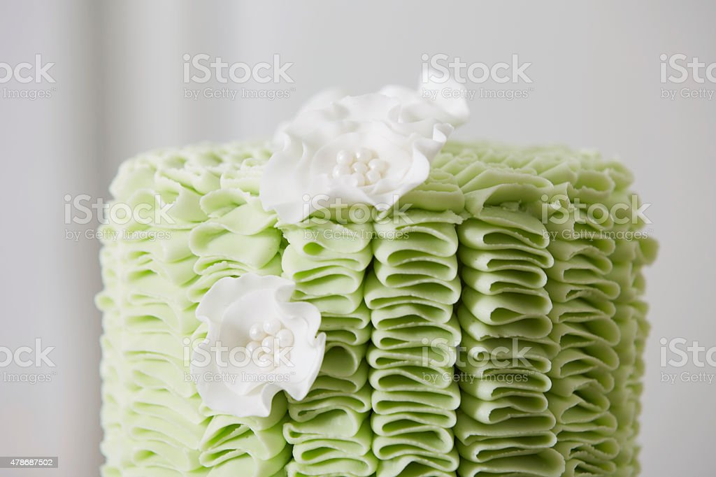 Cake with Fondant Ruffles and Sugar Flowers stock photo