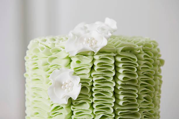 Cake with Fondant Ruffles and Sugar Flowers stock photo