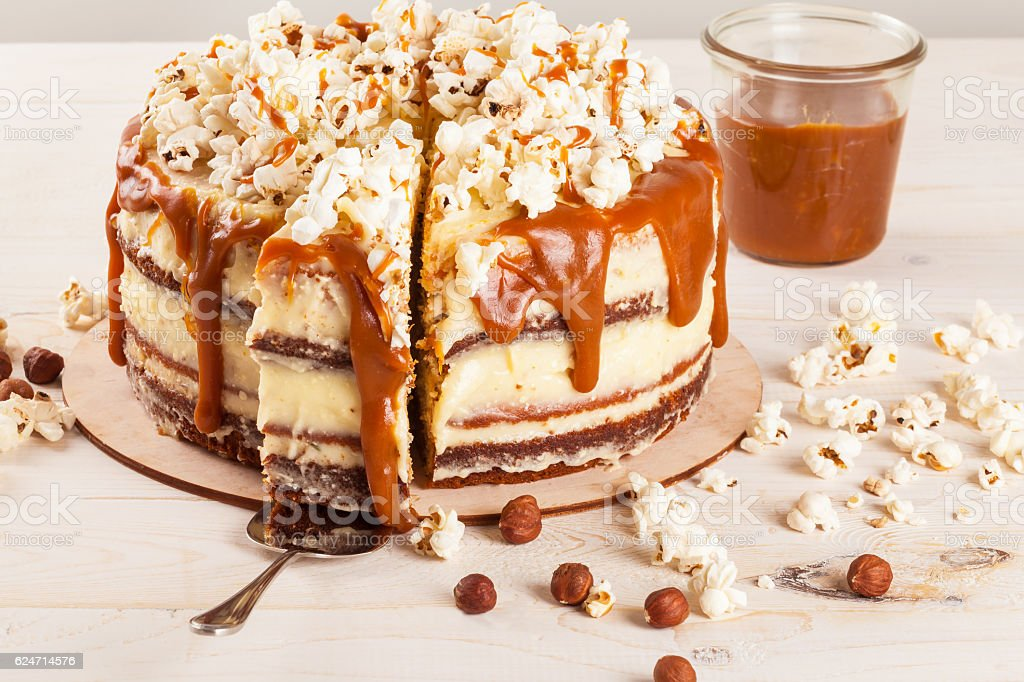 Cake with hazelnuts and homemade salted caramel. stock photo