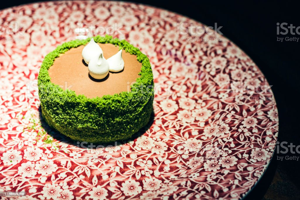cake with meringue and cream custard on the red plate in restaurant
