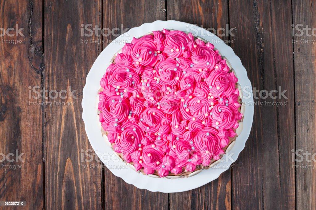 Cake with pink cream on white wood background. Pink cake zbiór zdjęć royalty-free