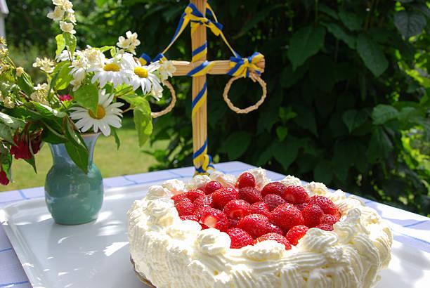 cake with strawberries and cream at a table - midsommar bildbanksfoton och bilder