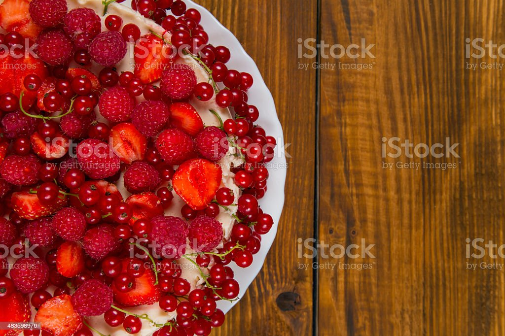 Cake with strawberries and raspberries currants stock photo