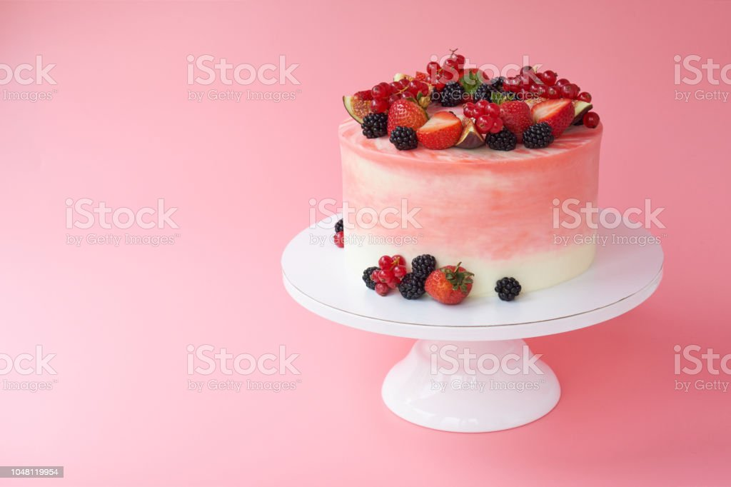 Cake With Whipped Pink Cream Decorated With Fresh Strawberries